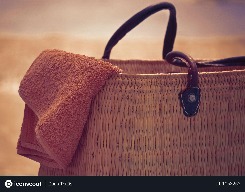Free Brown Basket Bag With Orange Hand Towel Photo