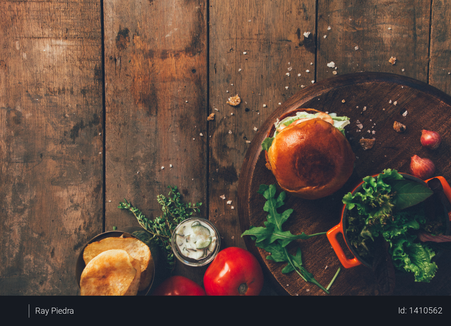 Burger and Vegetables Placed on Brown Wood Surface Photo