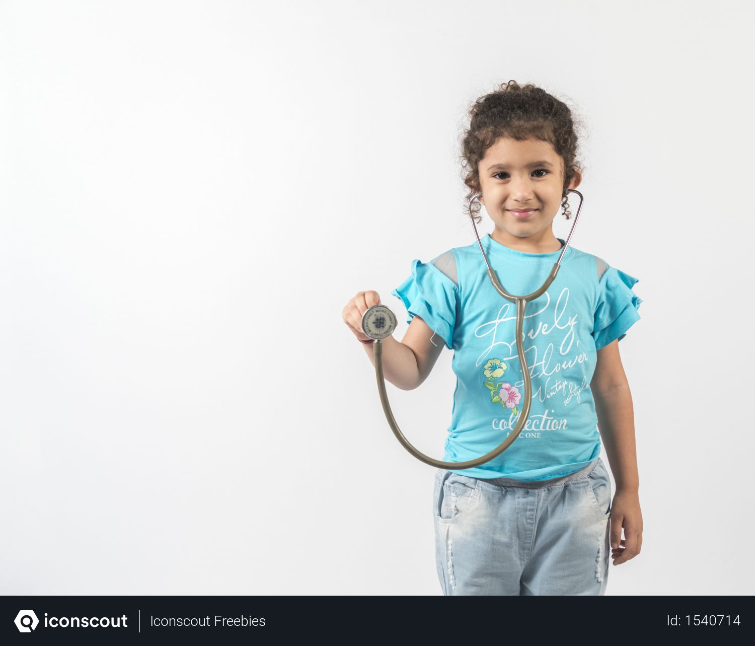 Free Cute girl act as doctor while holding a stethoscope