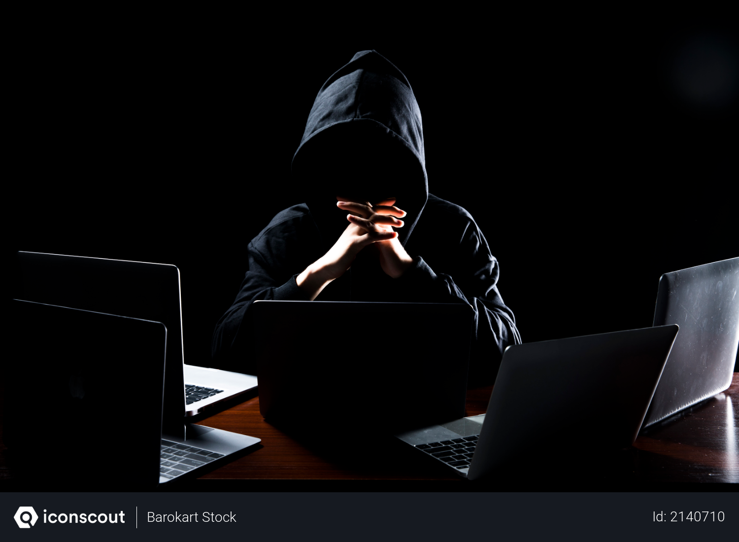 Free Hacker Wearing Hoodie With Laptop And Dark Lighting As Hacking Concept Photo Download In Png Jpg Format