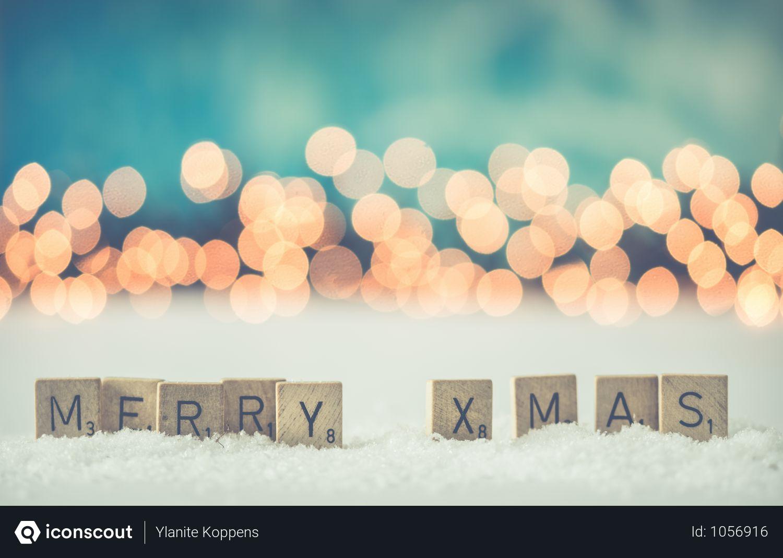 Merry Xmas Scrabble Blocks With Yellow Light Bokah Photo