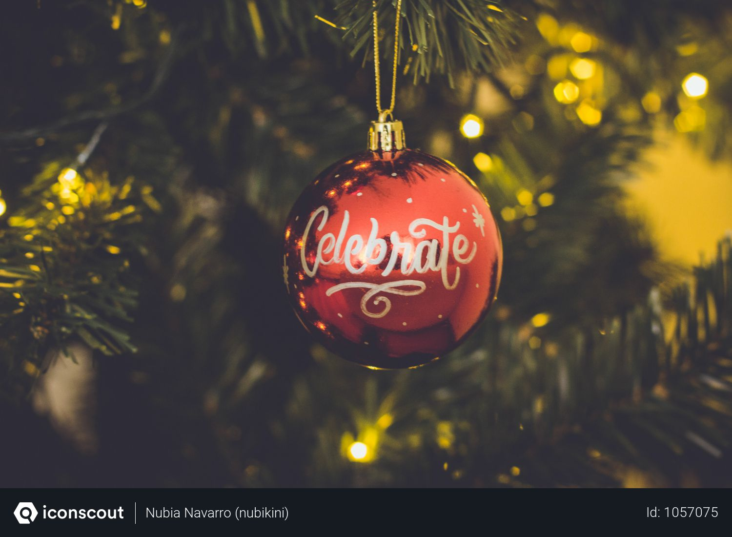 Red Celebrate Print Baubles Hang On Green Christmas Tree Photo