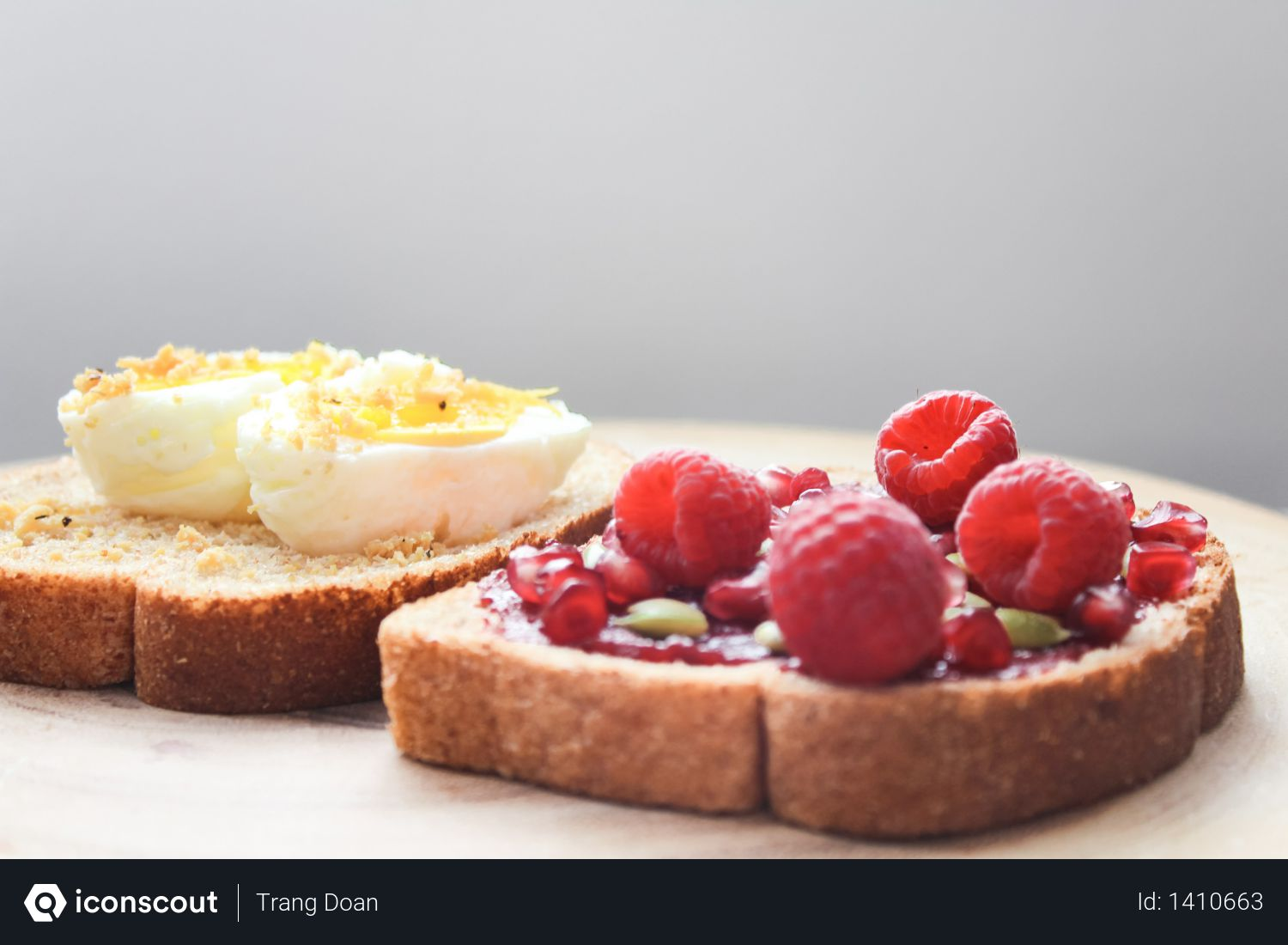 Two Boiled Egg and Raspberries on Loaf Bread Photo