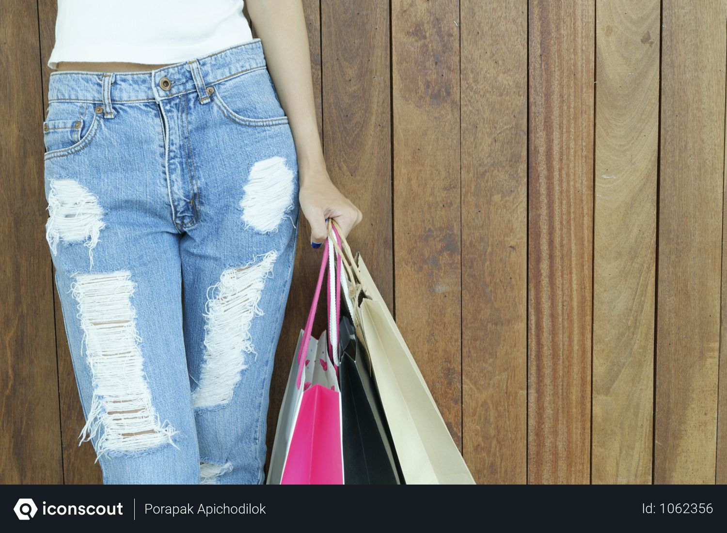 Free Woman In Ripped Jeans Holding Shopping Bags Photo Download In Png Jpg Format