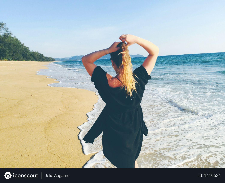 Woman Standing on Sea Shore Photo
