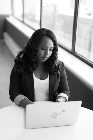 Black And White Photo Of Working Woman On Laptop