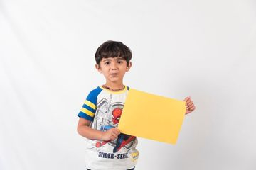 Kids Holding Coloring Boards Shoot