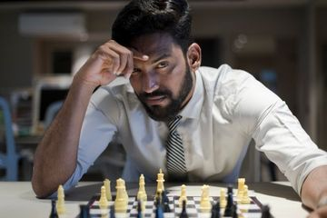 Businessman With Chess Stock Images