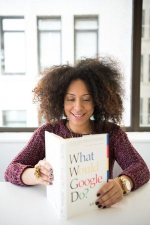 Woman With Curly Hair Reading Book