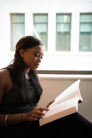 Women In Black Dress Reading Book