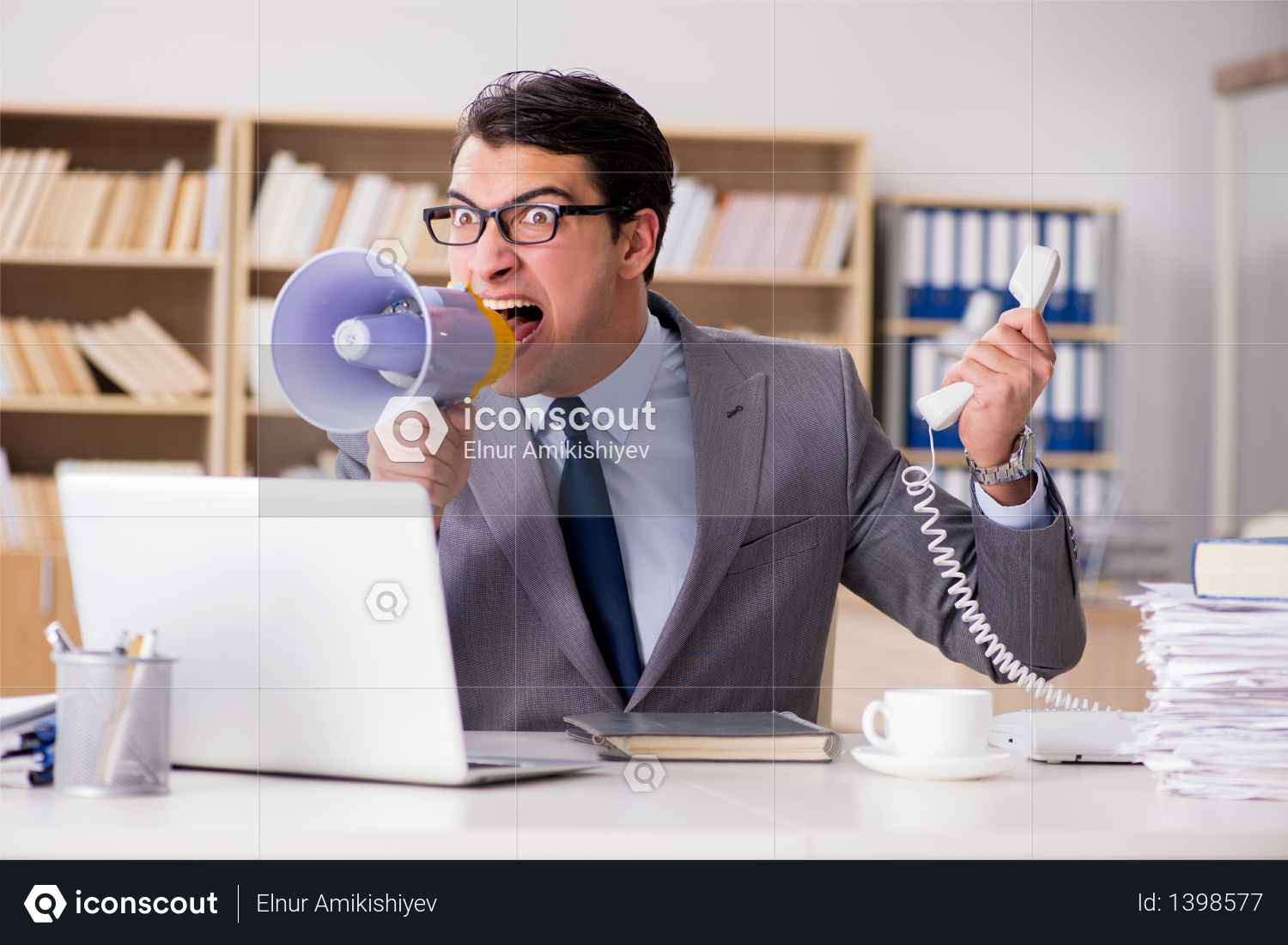 Angry businessman working in the office Photo