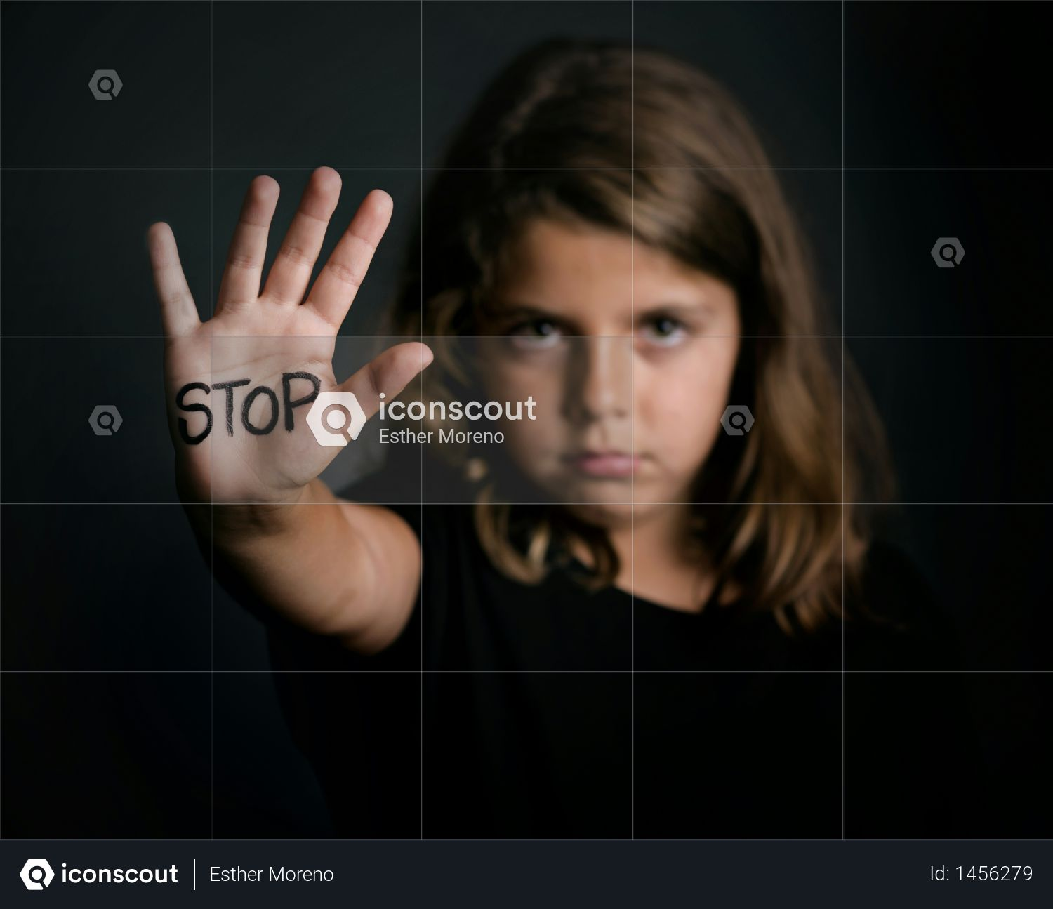 Angry girl showing hand signaling to stop violence Photo