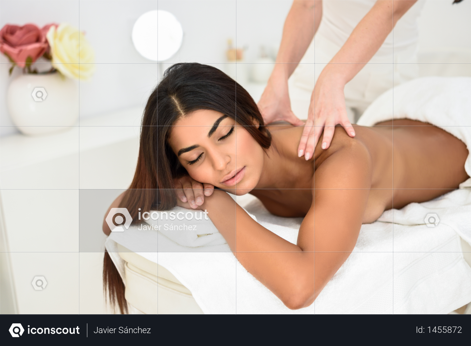 Arab woman receiving back massage in spa wellness center. Photo