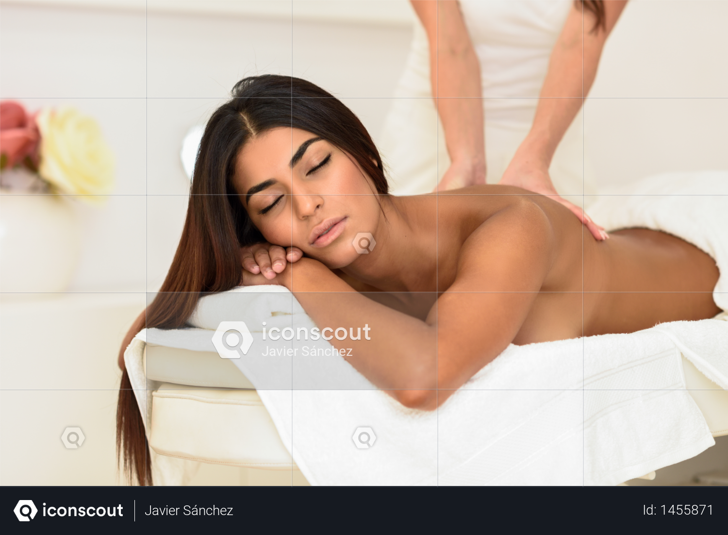 Arab woman receiving back massage in spa wellness center. Beauty and Aesthetic concepts. Photo