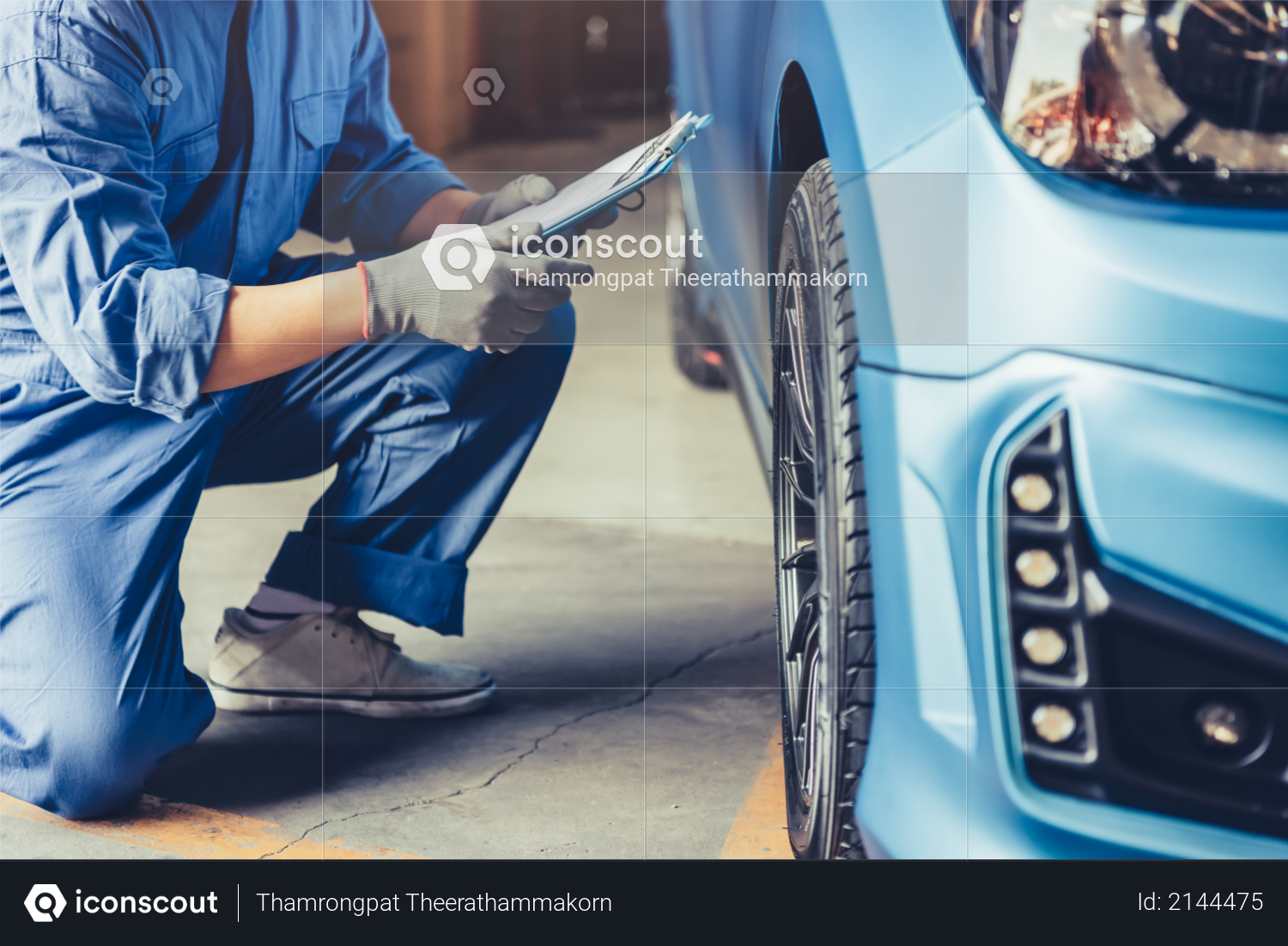 Asian car mechanic technician holding clipboard and checking to maintenance vehicle by customer claim order in auto repair shop garage, Wheel tire repair service, People occupation and business job Photo