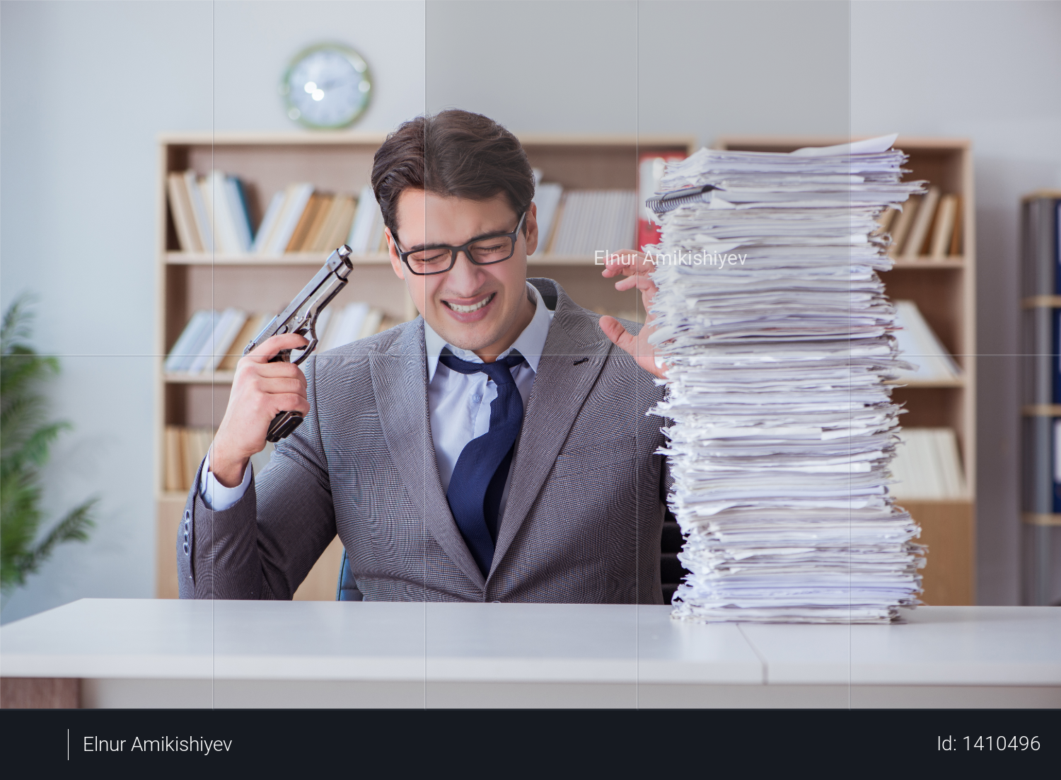 Businessman busy with paperwork in office Photo