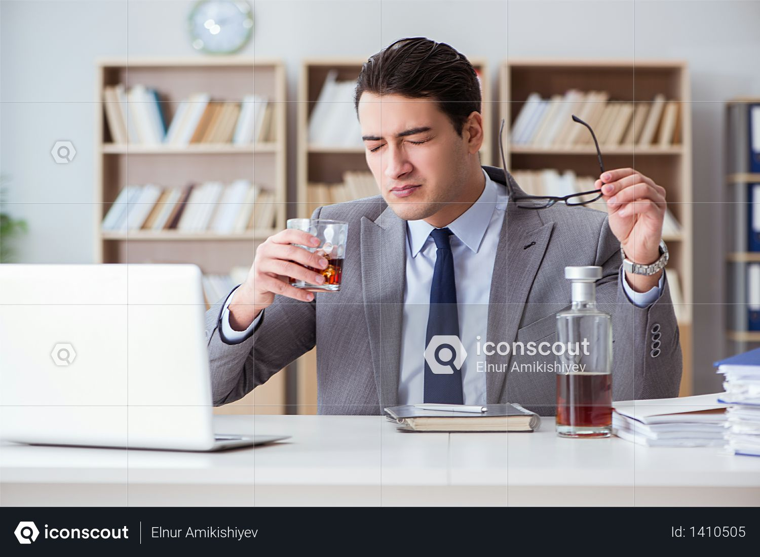 Businessman drinking in the office Photo