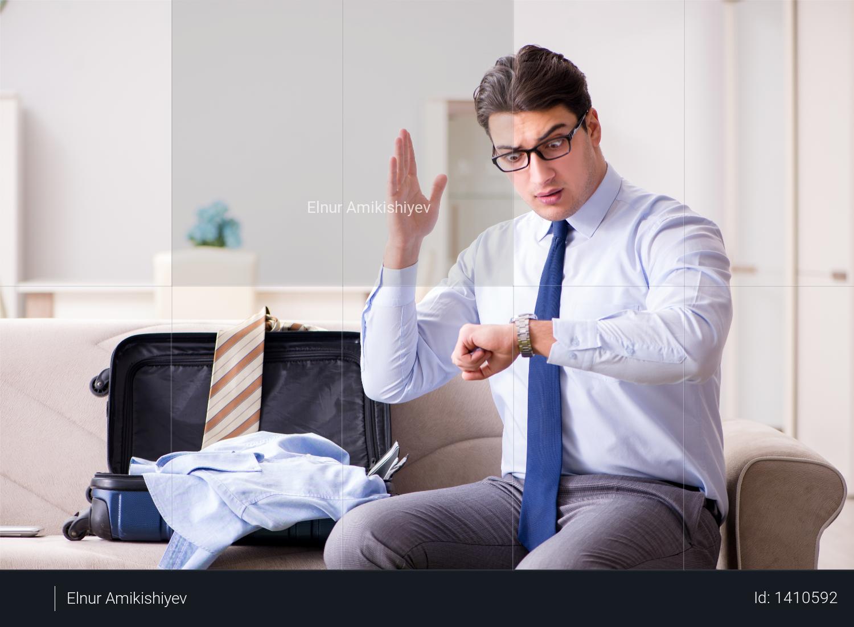 Businessman preparing for the business trip Photo