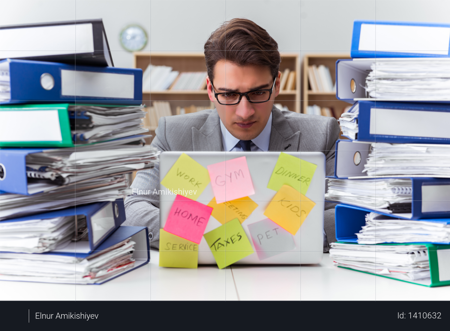 Businessman struggling with multiple priorities Photo