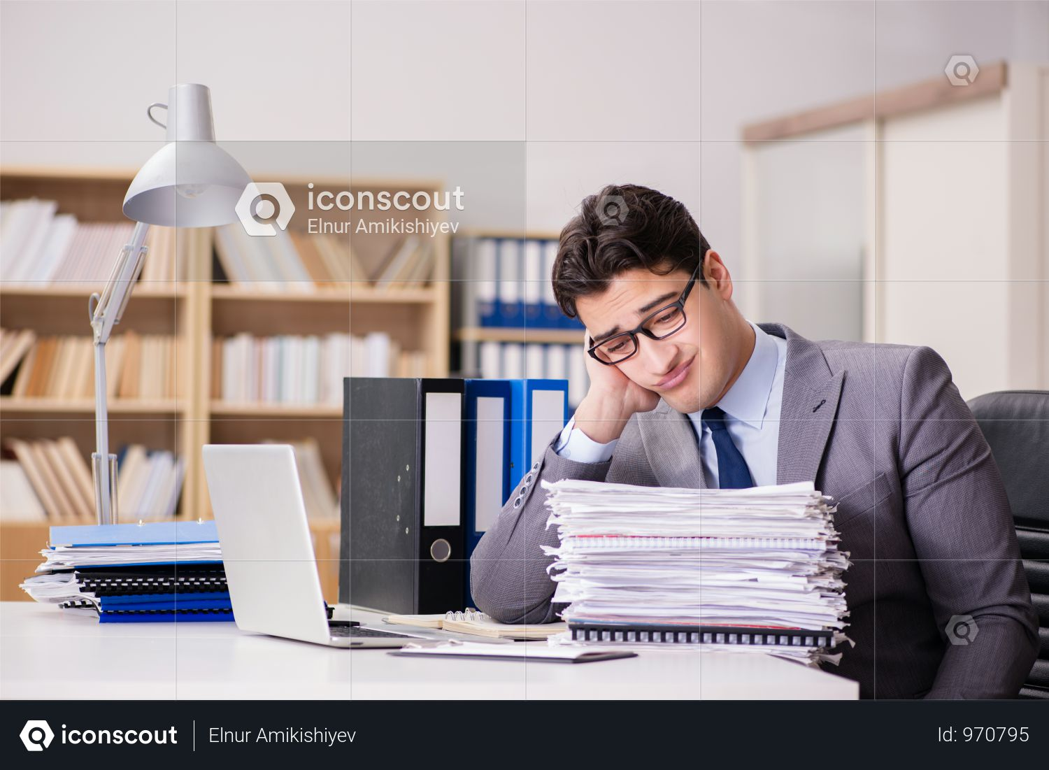 Businessman Struggling With Stacks Of Papers Photo