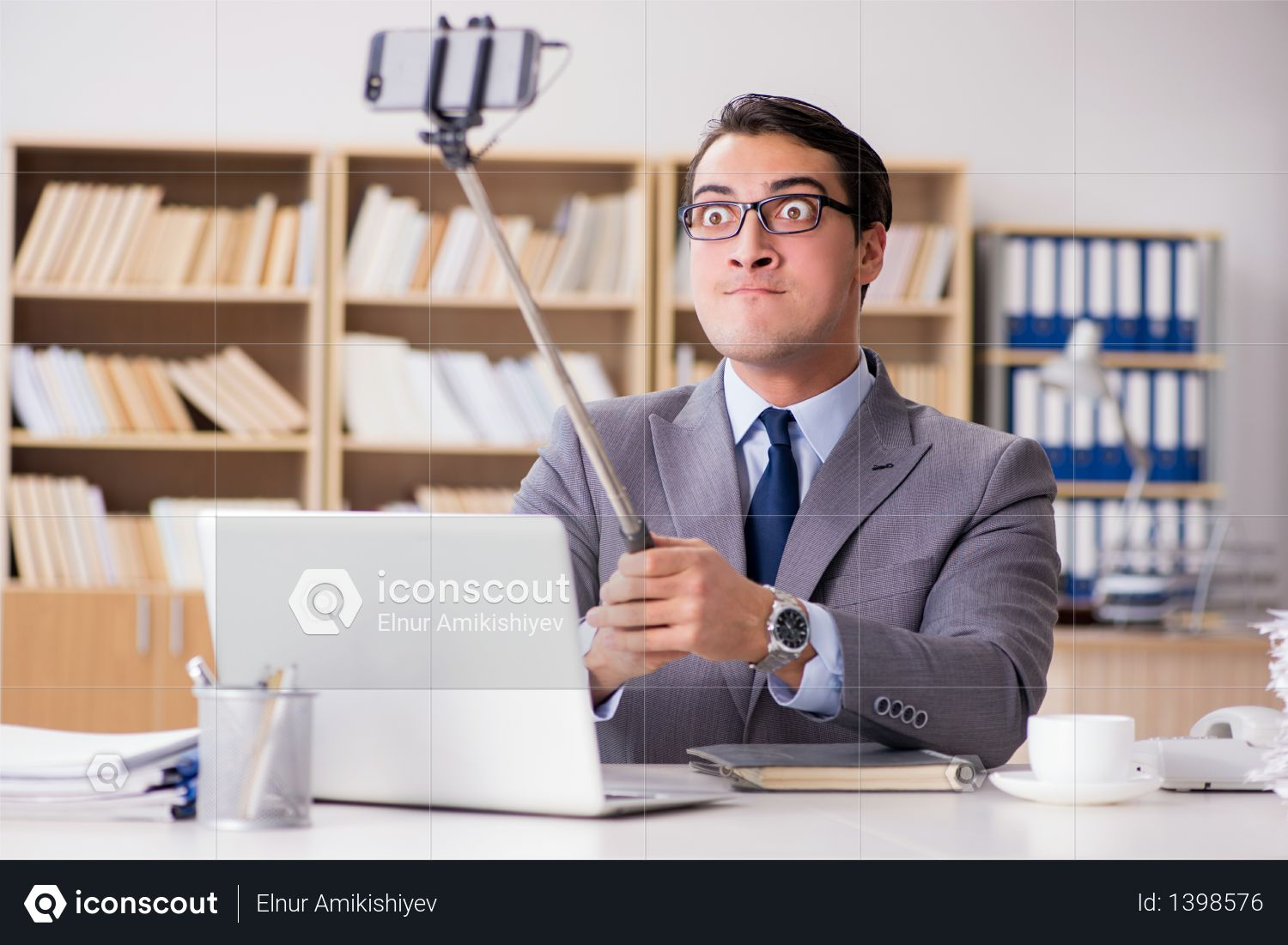 Businessman taking selfie in the office Photo