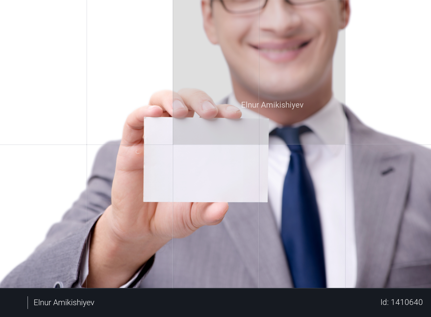 Businessman with blank card isolated on white background Photo