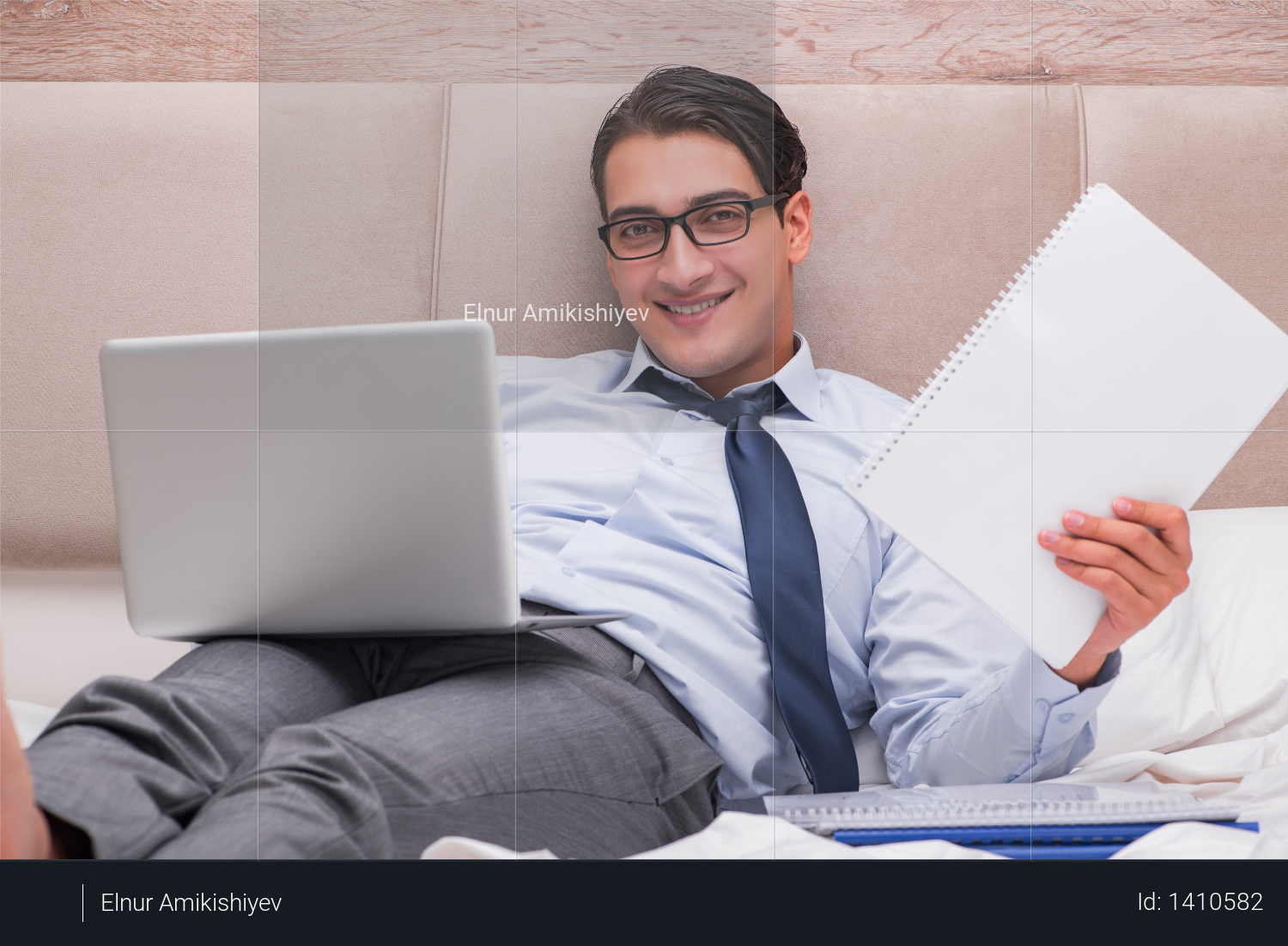 Businessman working in the bed at home Photo