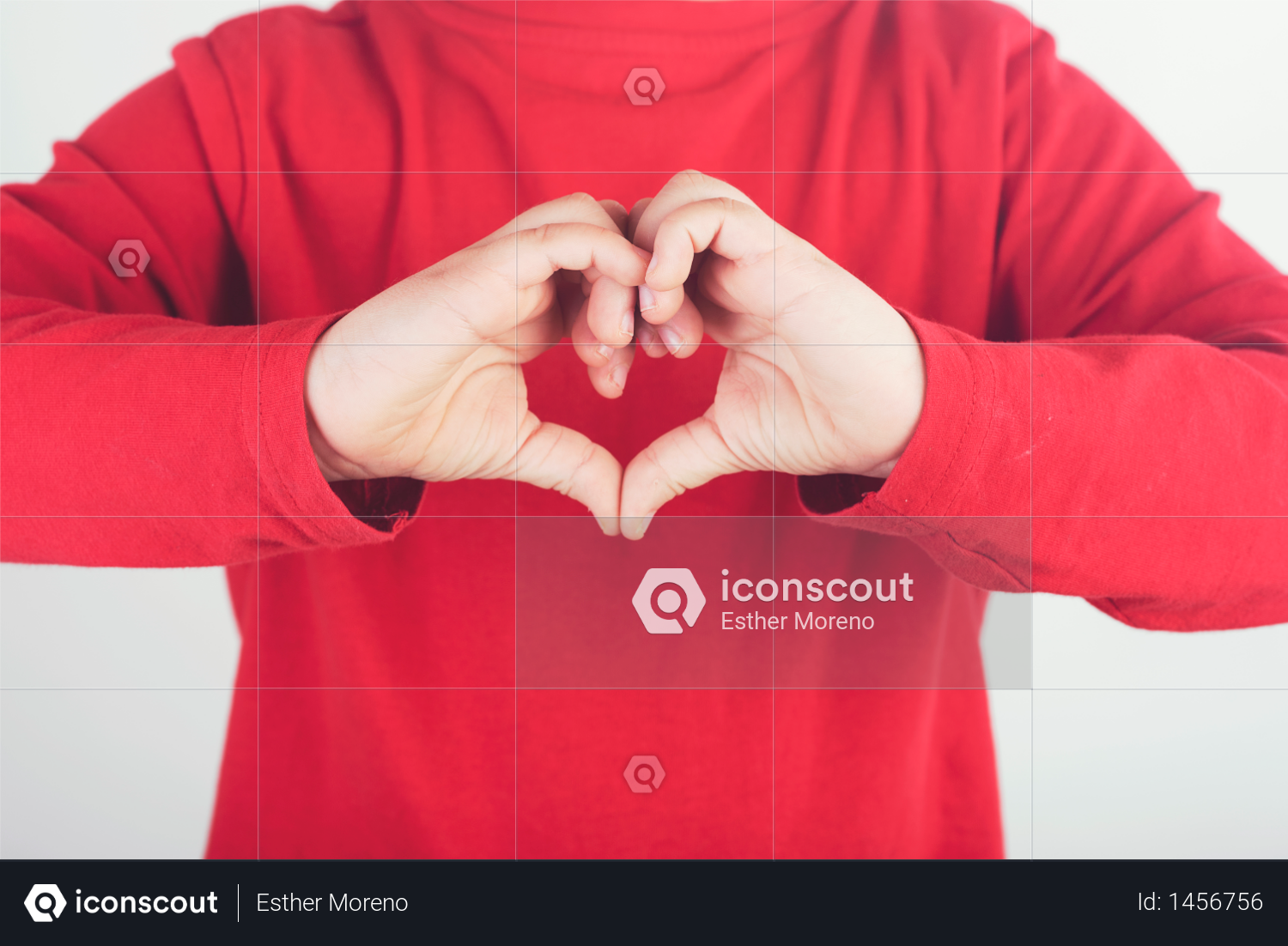 Child hands showing sign of heart Photo