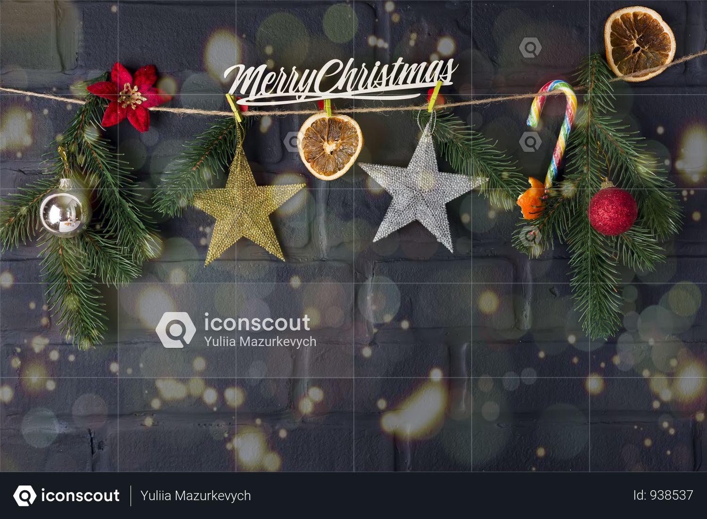 Christmas Fir Tree With Decoration On Dark Brick Background Photo
