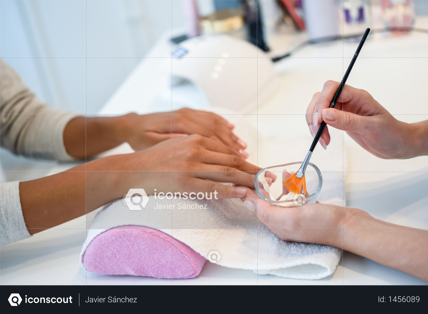 Close-up of beautician applying cream on woman's hand using brush. Handcare, taking care of hands, cosmetics concept. Photo