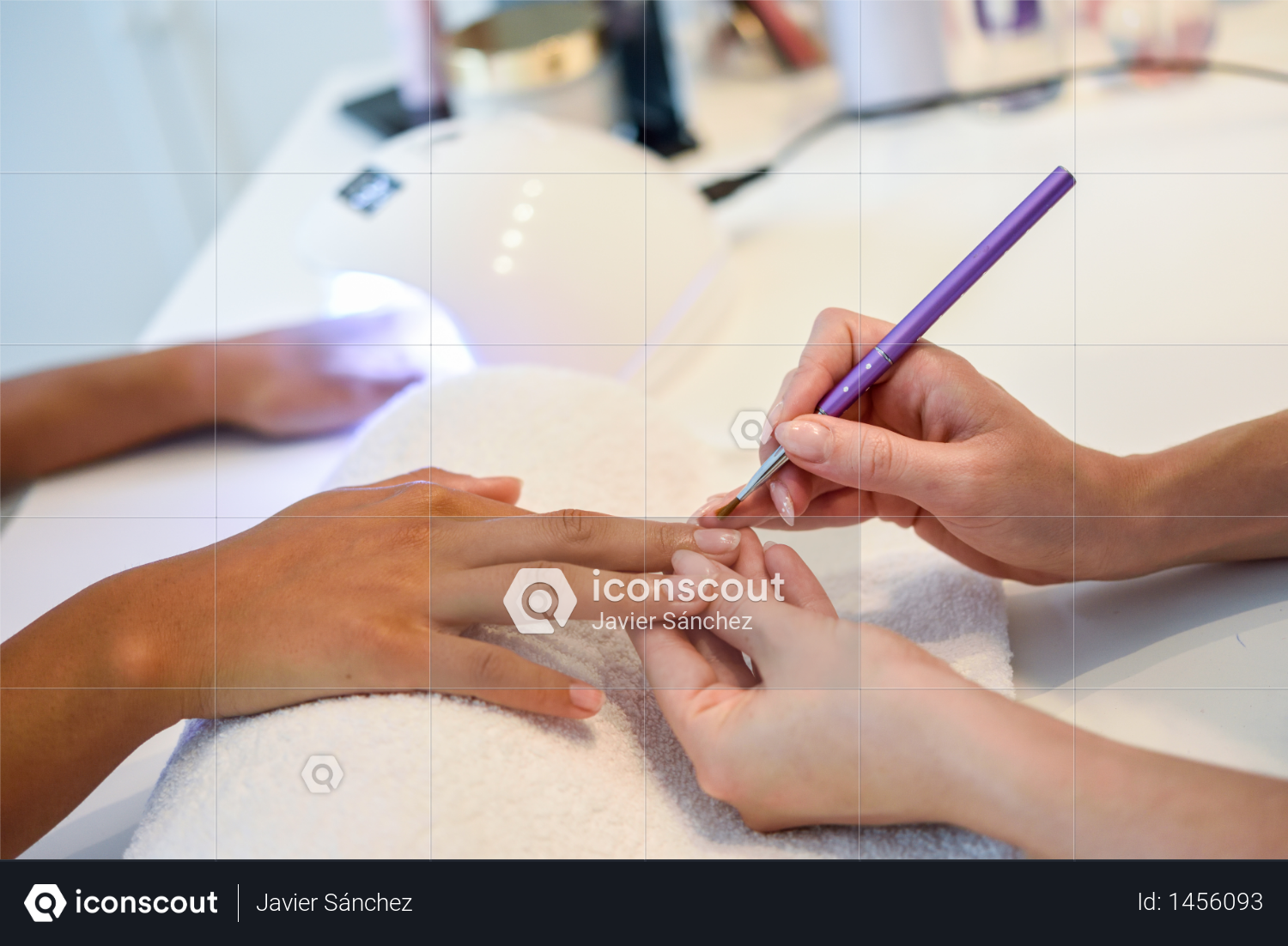 Close-up of beautician painting a woman's nails with a brush in a nail salon. Costumer receiving a manicure. Photo