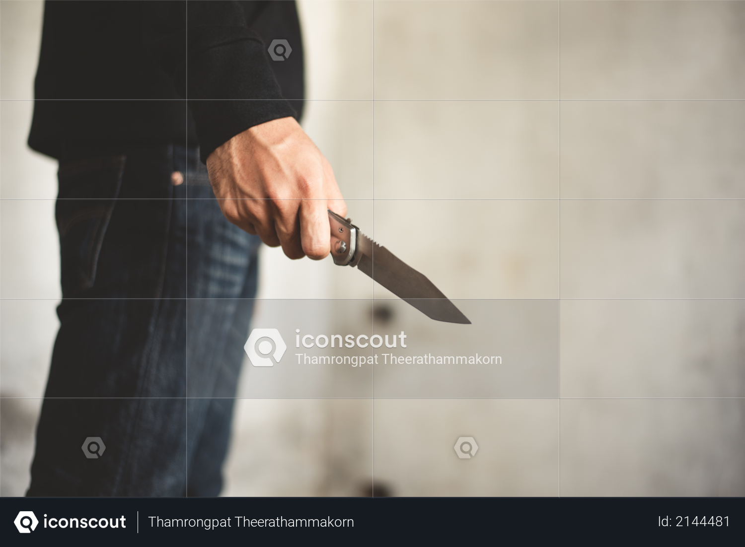 Close up of man holding knife in abandoned house - Terrorist and Robber concept Photo
