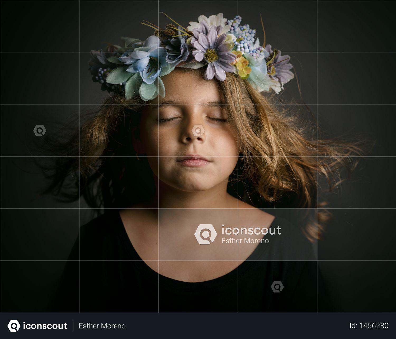 Cute little girl with flower wreath Photo