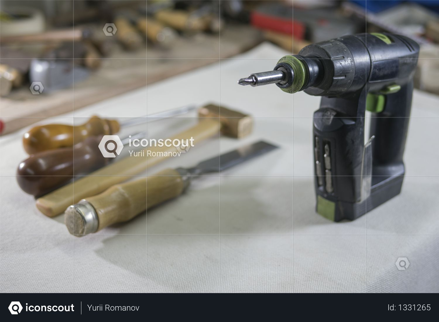 Drill screwdriver in the carpentry mater on the workbench Photo