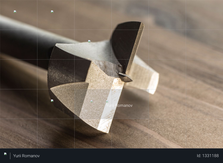 Forstner drill bit on the wooden bakground. joiner woodshop Photo
