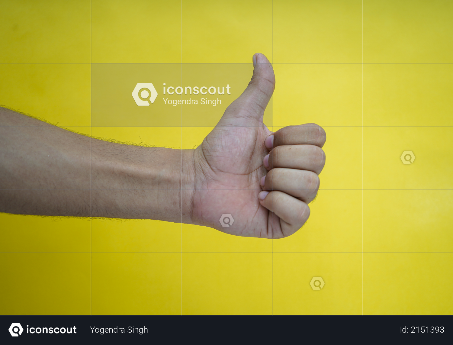 Hand showing thumbs up on a yellow background Photo