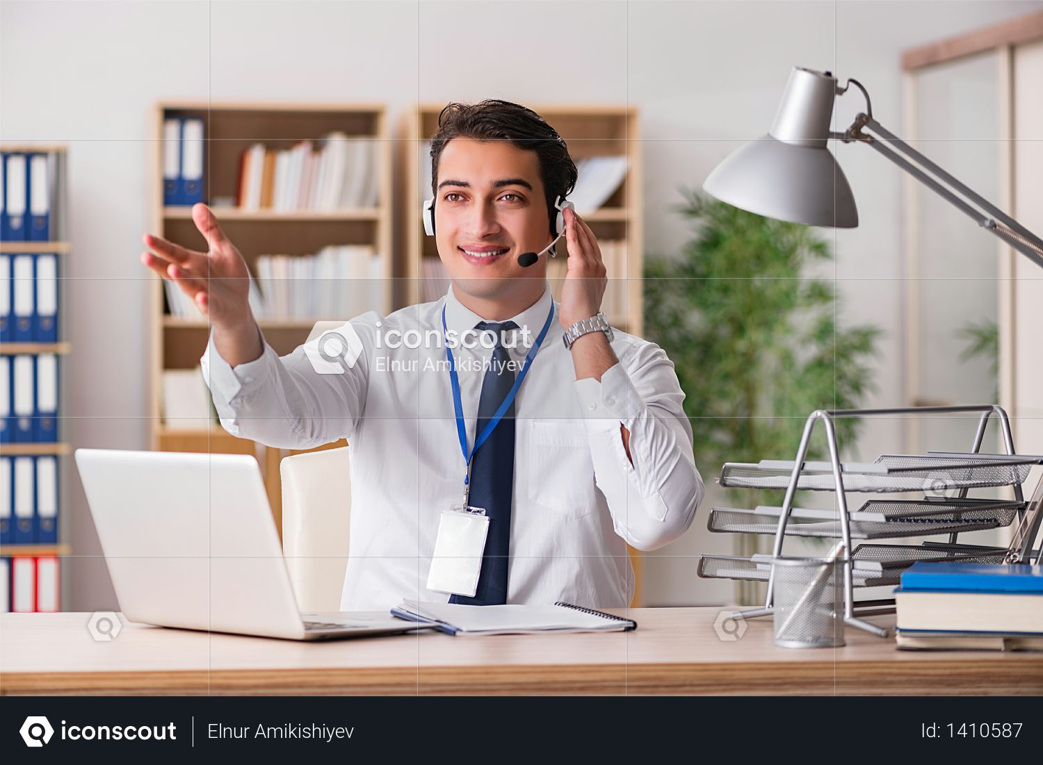 Handsome customer service clerk with headset Photo