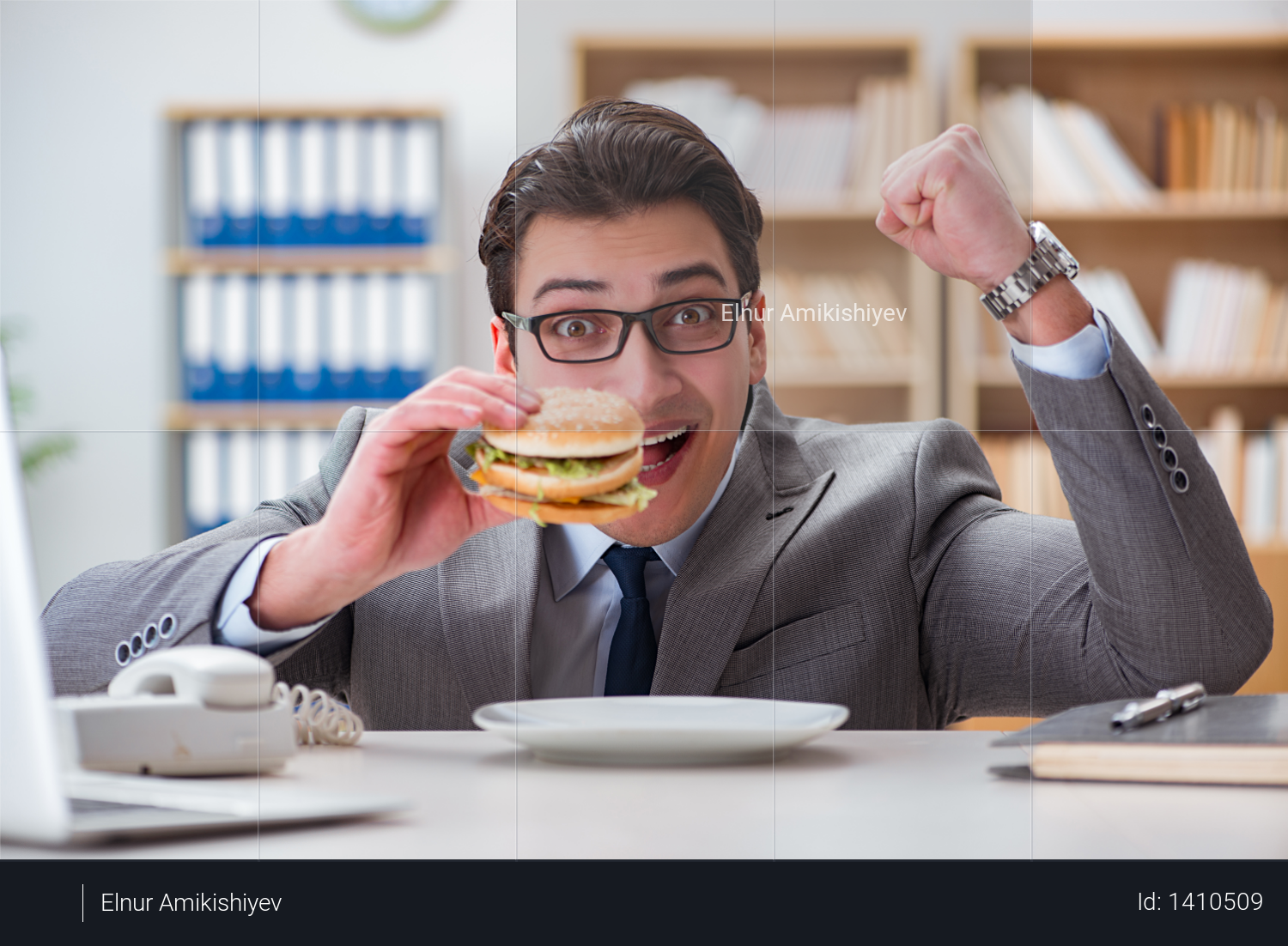 Hungry funny businessman eating junk food sandwich Photo