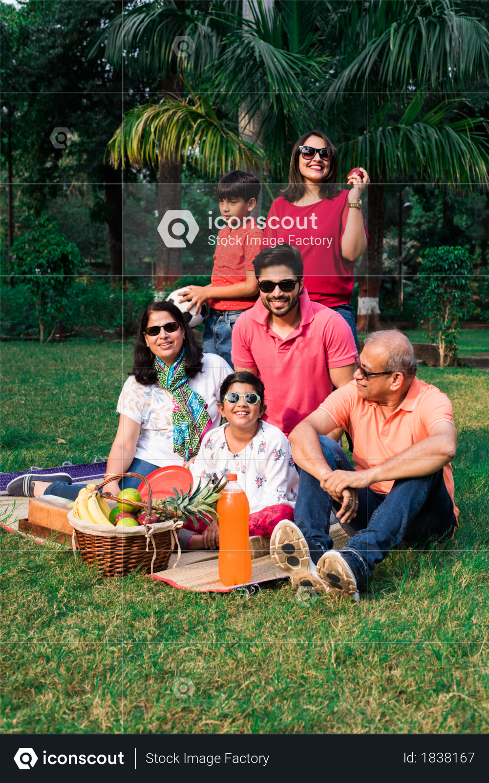 Indian Family enjoying picnic at garden Photo