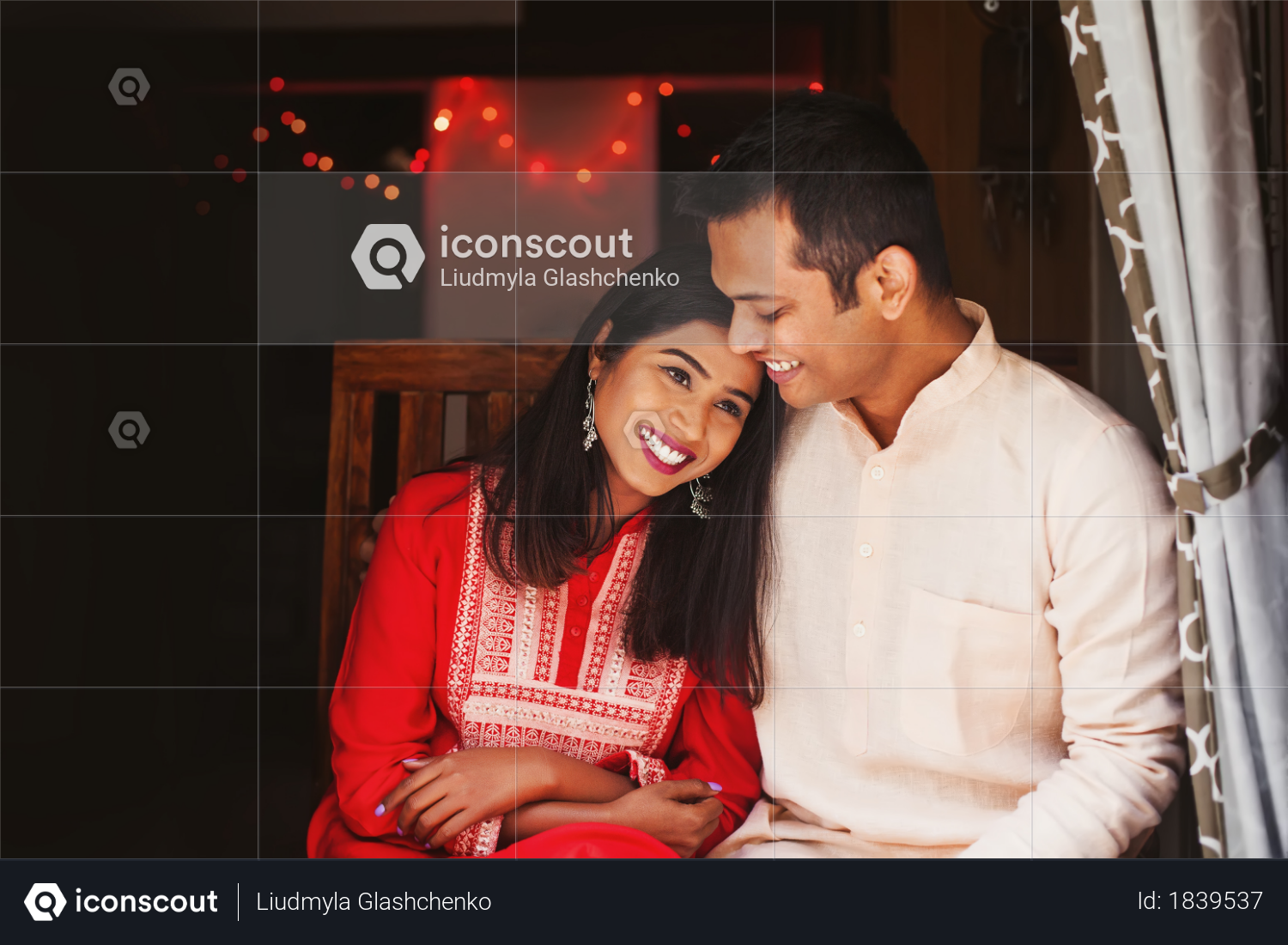 Indian man hugging his wife on karva chauth day Photo