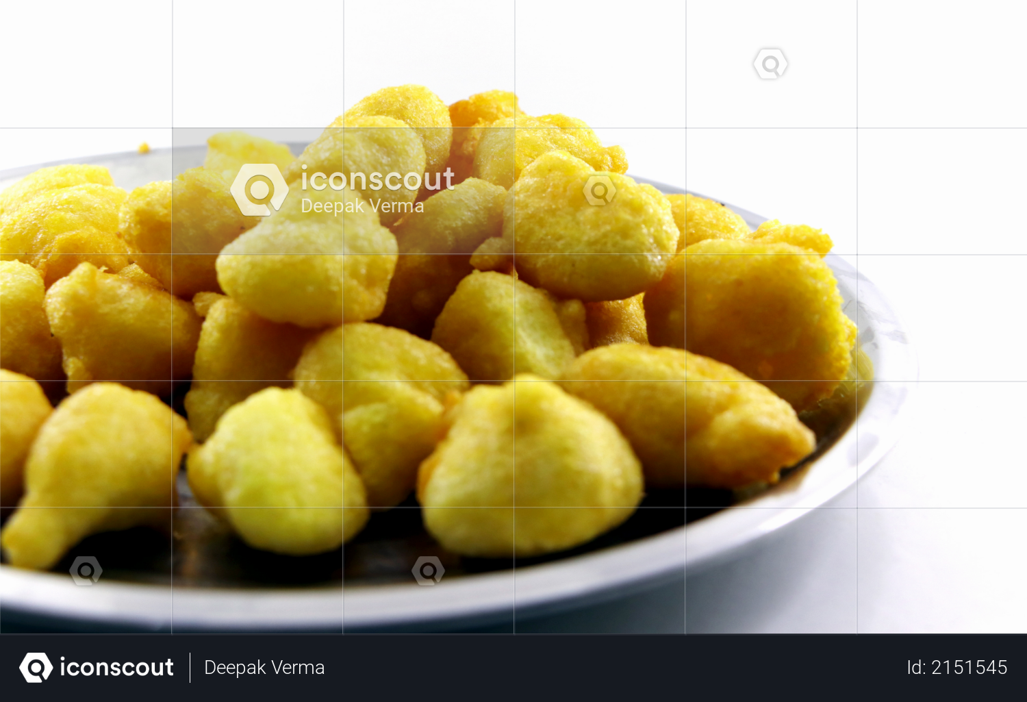 Isolated top view of Basin pakoda or pakora, Top shot of Popular indian or pakistani street food snack on white background Photo