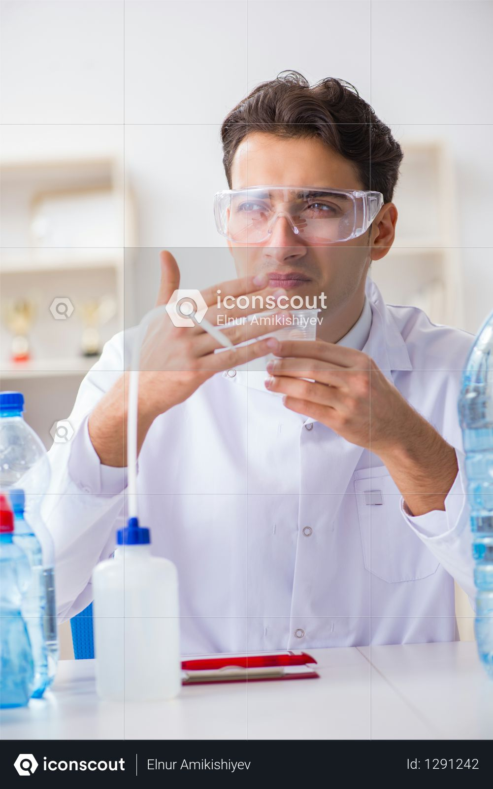 Lab assistant testing water quality Photo