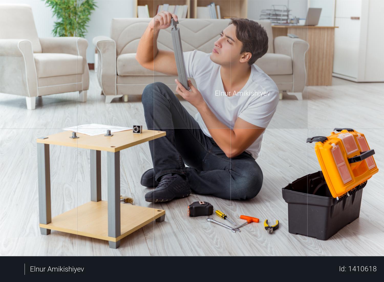 Man assembling furniture at home Photo