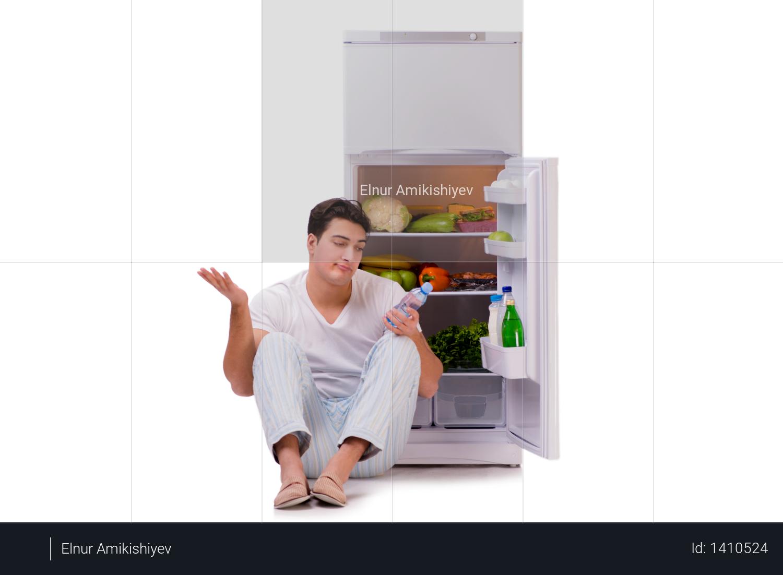 Man next to fridge full of food Photo