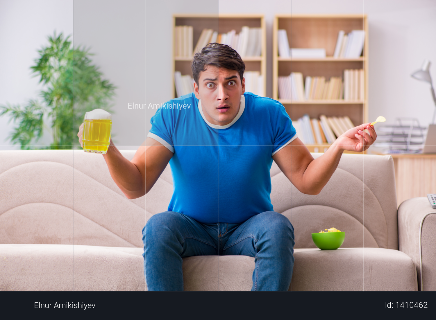 Man watching football at home sitting in couch Photo