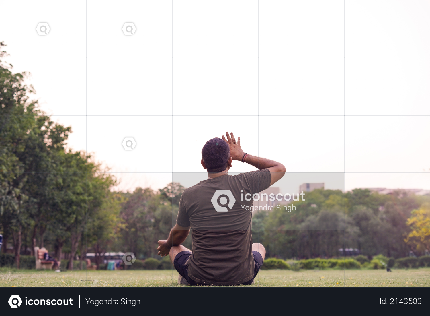 Mid-aged Man doing yoga in a park covered with trees, anulom vilom pranayam Photo