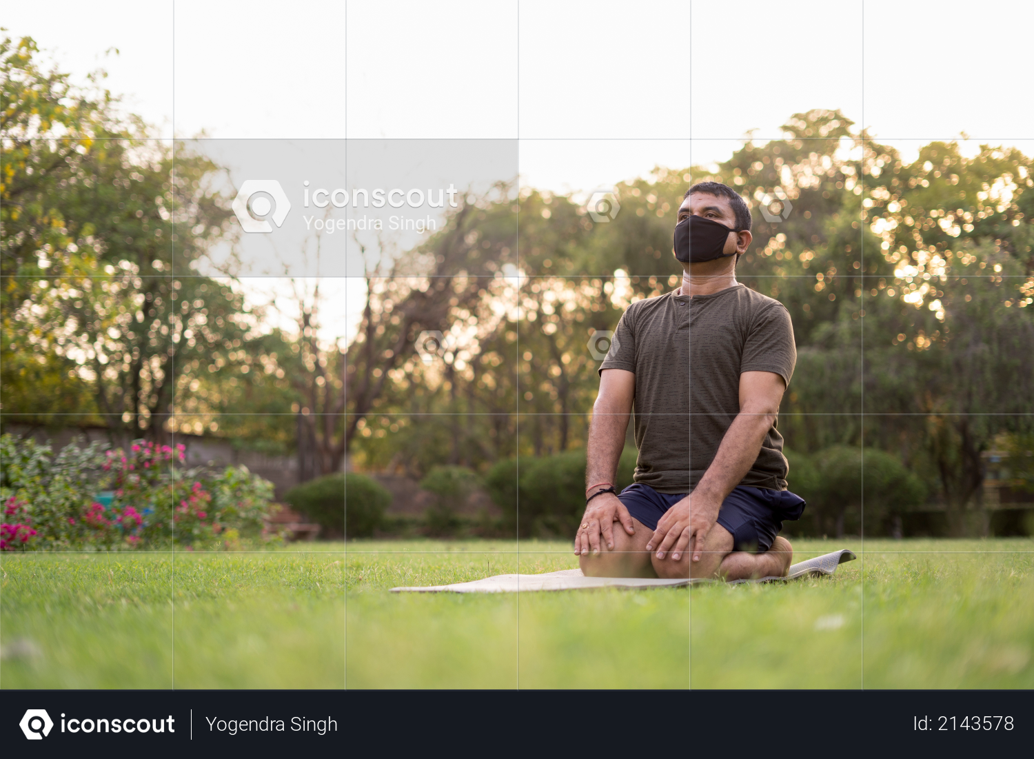 Mid-aged Man doing yoga in a park covered with trees on International Yoga Day Photo