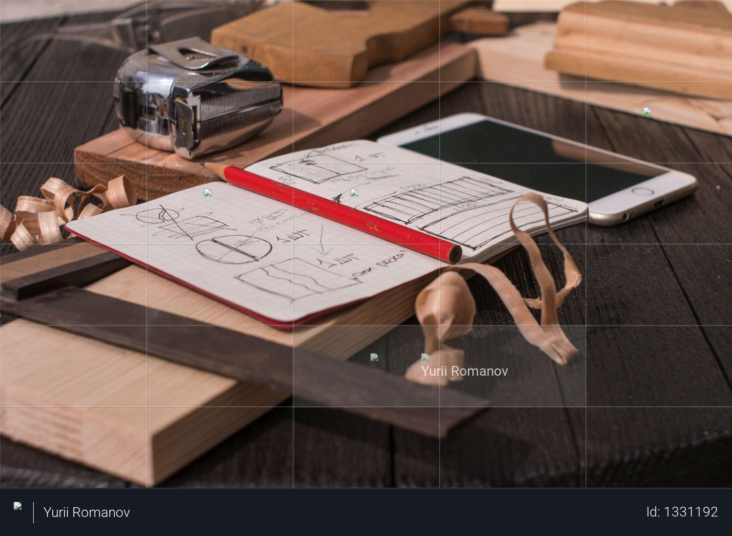 Notebook with drawings, chips, pencil, tape measure, smartphone, square and plane on a black table Photo
