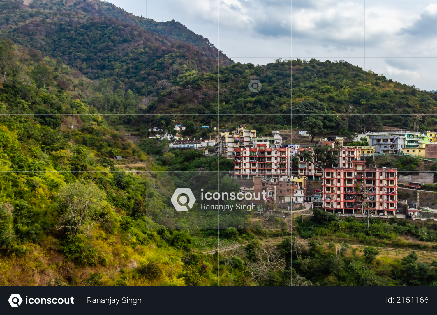 Photography of buildings with mountain range and cloudy sky in the background Photo