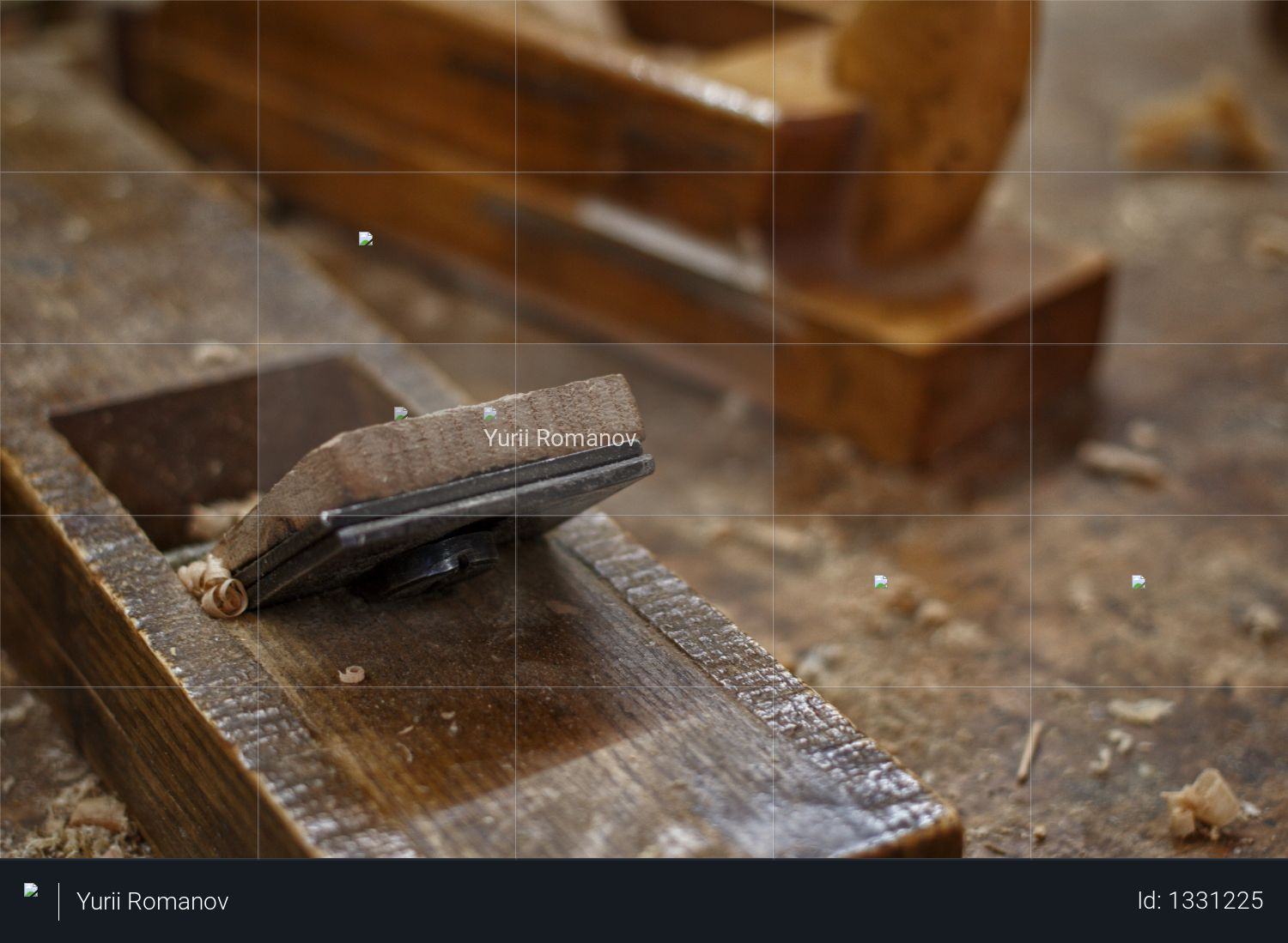 Plane and shavings in workshop Photo